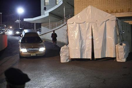 A vehicle believed to be carrying the body of pop singer Whitney Houston arrives at the Whigham funeral home in Newark, New Jersey February 13, 2012. REUTERS/Eduardo Munoz