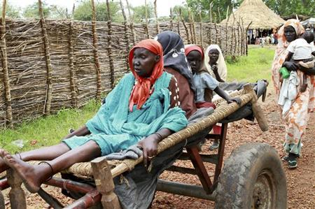 A woman is transported on a cart to the International Medical Corps' clinic in Gendrassa camp in Maban, Upper Nile State, South Sudan, on the border with Sudan, August 1, 2012. REUTERS/Margaret Aguirre/International Medical Corps/Handout