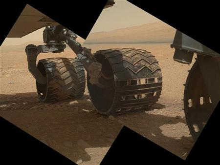A NASA handout photo shows the three left wheels of NASA's Mars rover Curiosity combined in two images that were taken by the rover's Mars Hand Lens Imager (MAHLI) on September 9, 2012. REUTERS/NASA/JPL-Caltech/Malin Space Science Systems/Handout