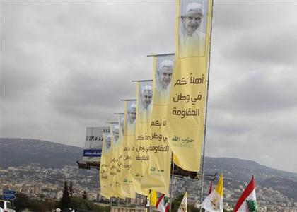 Banners erected by Hezbollah depicting Pope Benedict XVI as well as Lebanese and Vatican flags decorate a main airport road in Beirut, September 13, 2012. REUTERS/ Mohamed Azakir