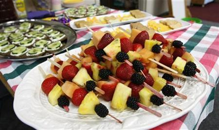 The food at the Lookout Mountain Preschool including fruit kabobs are readied for a healthy school party for Mother's Day in Golden, Colorado May 10, 2012. REUTERS/Rick Wilking