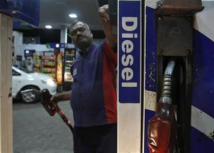 A worker switches on a fuel pump before filling a car with diesel at a fuel station in New Delhi September 13, 2012. REUTERS/Mansi Thapliyal