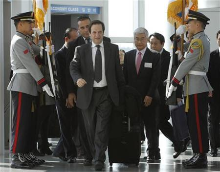 Israel's Deputy Prime Minister Dan Meridor (front) arrives at the Incheon International Airport ahead of the Nuclear Security Summit in Seoul March 25, 2012. REUTERS/Kim Hong-Ji