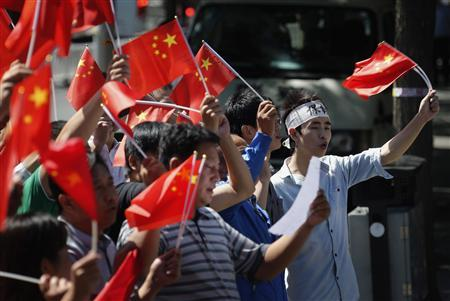 Demonstrators wave Chinese national flags during a protest outside the Japanese embassy in Beijing September 14, 2012. REUTERS/David Gray