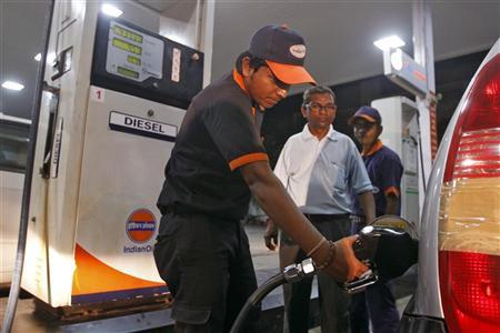 A worker fills a car with diesel at a fuel station in Ahmedabad September 13, 2012. REUTERS/Amit Dave