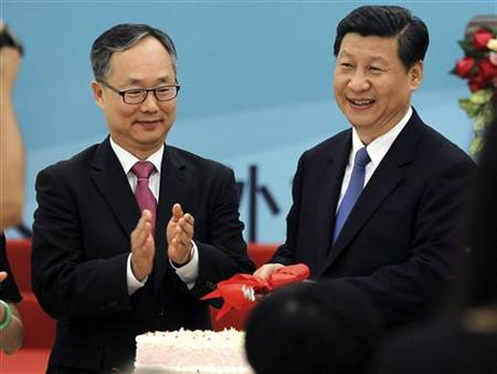Xi Jinping (R) and the Republic of Korea (ROK)'s Ambassador to China, Lee Kyu-hyung (L), cut a cake at a reception to celebrate the 20th anniversary of the establishment of diplomatic ties between China and Republic of Korea in Beijing, August 31, 2012. REUTERS/China Daily