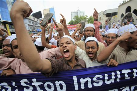 Bangladeshi Muslims shout slogans during a protest in front of the National Mosque in Dhaka September 14, 2012. Around 10,000 Muslims from half a dozen Islamist groups staged a noisy protest in the capital Dhaka on Friday over the U.S. film said to have insulted the Prophet Mohammad. REUTERS/Andrew Biraj