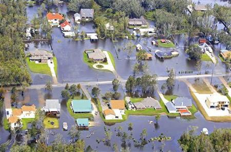 Flood waters from Hurricane Isaac partially submerge homes in neighborhoods in Lafitte, Louisiana August 31, 2012. REUTERS/Sean Gardner