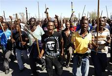 Mine workers take part in a march at Lonmin's Marikana mine in South Africa's North West Province September 10, 2012. REUTERS/Siphiwe Sibeko