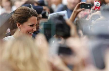 Catherine, Britain's Duchess of Cambridge, greets well-wishers at KLCC Park in Kuala Lumpur September 14, 2012. REUTERS/Bazuki Muhammad