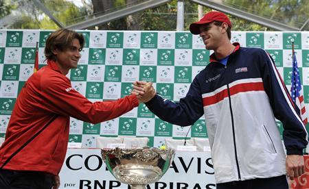 Sam Querrey (R) of the U.S. shake hands with David Ferrer of Spain behind the Davis Cup trophy after the official draw of their the Davis Cup World Group semi-final match in Gijon, northern Spain September 13, 2012. REUTERS/Eloy Alonso
