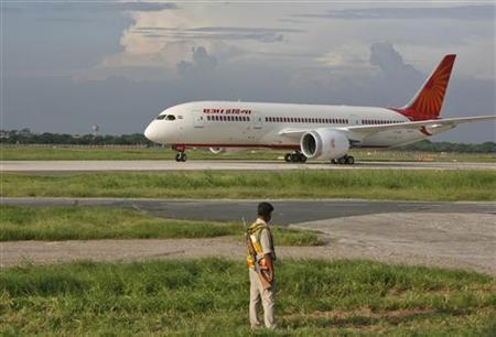 A security personnel stands guard as Air India's Dreamliner Boeing 787 taxies upon its arrival at the airport in New Delhi September 8, 2012. REUTERS/Mansi Thapliyal