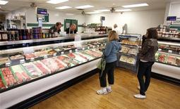 Customers wait to be served at Casey's Market in Western Springs, Illinois, April 25, 2012. REUTERS/Jeff Haynes