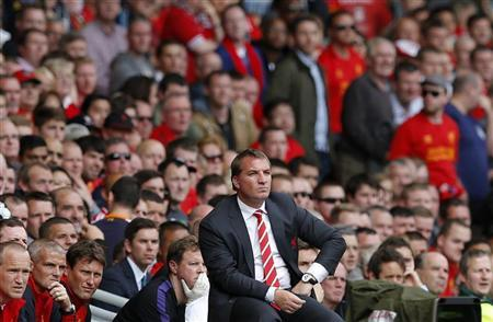 Liverpool's manager Brendan Rodgers watches his team play Arsenal as fans leave early during their Premier League match at Anfield in Liverpool, northern England September 2, 2012. REUTERS/Phil Noble