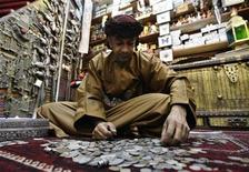 An Omani man sits in his antiques shop in Mattrah Souq, the oldest market in Oman, in the capital Muscat June 7, 2010. REUTERS/Fahad Shadeed