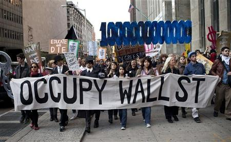 Occupy Wall Street demonstrators march through the streets during a protest against the rising national student debt, in New York, April 25, 2012. REUTERS/Andrew Burton