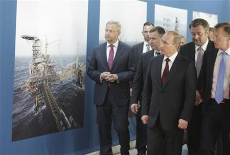 Russian Prime Minister Vladimir Putin (front) listens to A.P. Moller-Maersk group Chief Executive Officer Nils Andersen (R) during his visit to the company's headquarters in Copenhagen April 26, 2011. REUTERS/Alexei Druzhinin/RIA Novosti/Pool