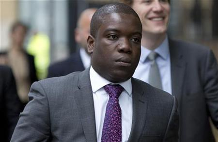 Former UBS trader Kweku Adoboli arrives at Southwark Crown Court in London September 14, 2012. Adoboli, who was arrested a year ago when a loss of $2.3 billion came to light, is charged with fraud and false accounting. REUTERS/Neil Hall