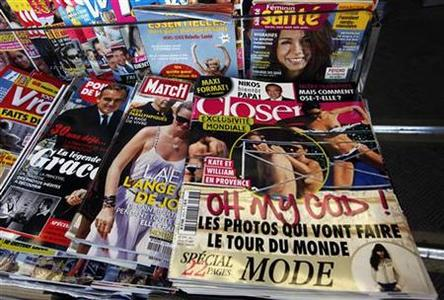 Copies of French magazine Closer showing pictures of Catherine, Duchess of Cambridge, and Britain's Prince William are displayed in a newspaper kiosk in Nice September 14, 2012. REUTERS/Eric Gaillard