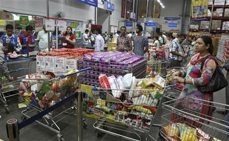 Customers wait to pay for their goods at a Best Price Modern Wholesale store, a joint venture of Wal-Mart Stores Inc and Bharti Enterprises, at Zirakpur in Punjab September 14, 2012. REUTERS/Ajay Verma