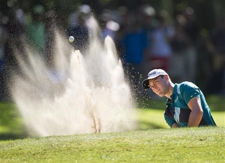 German's Martin Kaymer plays a shot out of the bunker of the 14th hole of the Dutch Open Golf Tournament in Hilversum September 9, 2012. REUTERS/Paul Vreeker/United Photos