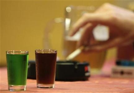 Two shots of liquor are seen at a bar in Prague September 12, 2012. Fourteen people have died in the Czech Republic and at least 20 are in hospital after drinking bootleg vodka and rum containing methanol, police said on Wednesday, in the worst case of fatal alcohol poisoning in the country in at least 30 years. REUTERS/David W Cerny