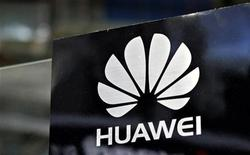 A Huawei logo is seen above the company's exhibition pavilion during the CommunicAsia information and communications technology trade show in Singapore June 19, 2012. REUTERS/Tim Chong