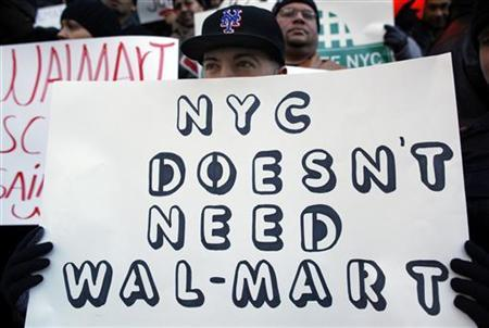 Anti-Walmart protesters gather on the steps of City Hall in New York, February 3, 2011. REUTERS/Brendan McDermid