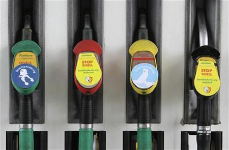 Greenpeace environmental stickers are seen on gas pumps at a Shell gas station in Prague September 13, 2012. REUTERS/David W Cerny