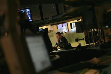 A traders works on the floor of the New York Stock Exchange June 15, 2012. REUTERS/Eric Thayer