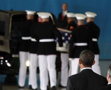 U.S. President Barack Obama watches as the body of an American killed in Benghazi this week is placed in a hearse during a return of remains ceremony at Andrews Air Force Base near Washington, September 14, 2012. REUTERS/Jason Reed