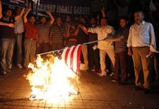Protesters burn a U.S. flag during a protest against a film produced in the U.S. that they said that was insulting to the Prophet Mohammad in Istanbul September 14, 2012. REUTERS/Osman Orsal