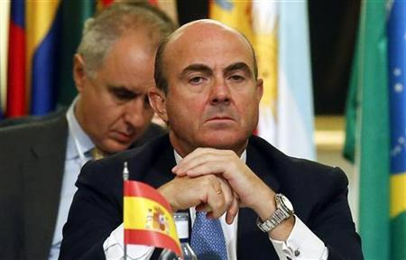 Spanish Economy Minister Luis de Guindos looks on during a meeting of Ibero-American finance ministers and delegations in Madrid September 11, 2012. REUTERS/Andrea Comas