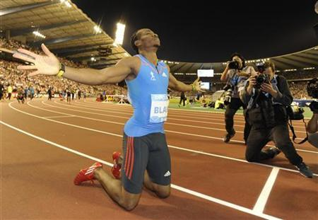 Yohan Blake of Jamaica reacts after winning the men's 200m event at the IAAF Diamond League athletics meeting, also known as Memorial Van Damme in Brussels September 7, 2012. REUTERS/Eric Vidal