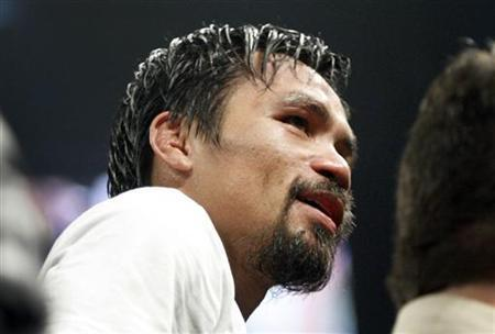Manny Pacquiao of the Philippines reacts after losing his WBO welterweight title fight against Timothy Bradley Jr. of the U.S. at the MGM Grand Garden Arena in Las Vegas, Nevada June 9, 2012. REUTERS/Steve Marcus