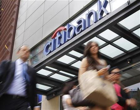 People walk past a Citibank branch in New York August 21, 2012. REUTERS/Brendan McDermid