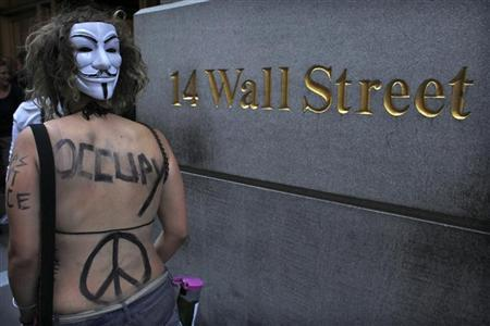 An Occupy Wall Street activist takes part in a march in downtown Manhattan in New York July 11, 2012. REUTERS/Eduardo Munoz