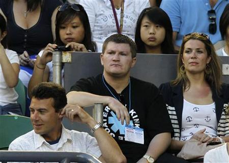 British boxer Ricky Hatton (C) watches the quarter-final match between Spain's Rafael Nadal and Britian's Andy Murray at the Australian Open tennis tournament in Melbourne January 26, 2010. REUTERS/Mick Tsikas