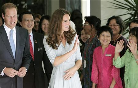 Britain's Prince William and Catherine, Duchess of Cambridge, wave to staff as they leave Hospis Malaysia, the largest hospice in the country, in Kuala Lumpur September 13, 2012. REUTERS/Samsul Said