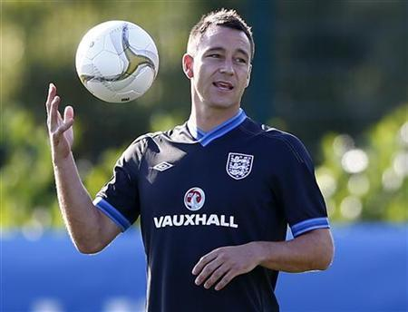 England's John Terry catches the ball during a soccer training session in London Colney, north of London, September 3, 2012. REUTERS/Darren Staples