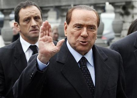 Italy's former Prime Minister Silvio Berlusconi arrives for a meeting of the European People's Party (EPP) ahead of a two-day European Union leaders summit in Brussels March 1, 2012. REUTERS/Sebastien Pirlet