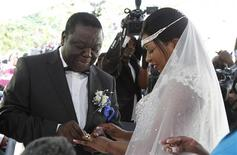 Zimbabwe's Prime Minister Morgan Tsvangirai and partner Elizabeth Macheka exchange rings after getting married under customary law in Harare, September 15, 2012. REUTERS/Philimon Bulawayo