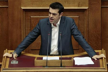 Head of radical left SYRIZA party Alexis Tsipras addresses parliamentarians during a session at the parliament in Athens July 7, 2012. REUTERS/Yorgos Karahalis
