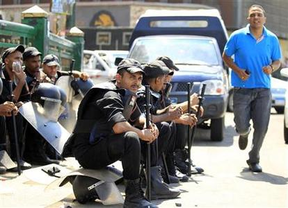 Riot policemen rest while clearing Tahrir Square and the area around the U.S embassy of demonstrators after clashes, at Tahrir Square in Cairo September 15, 2012. REUTERS/Mohamed Abd El Ghany