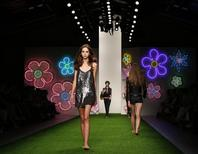 Models present creations from the Jasper Conran Spring/Summer 2013 collection at London Fashion Week September 15, 2012. REUTERS/Olivia Harris