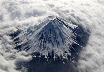 Japan's Mount Fuji, covered with snow and surrounded by cloud, is seen from an airplane in this February 2, 2010 file photo. REUTERS/Toru Hanai/Files