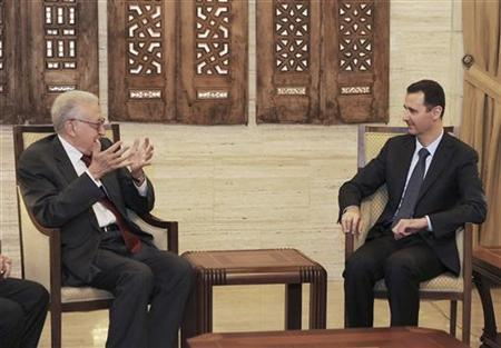 Syria's President Bashar al-Assad (R) meets with United Nations (U.N.)-Arab League peace envoy for Syria Lakhdar Brahimi in Damascus September 15, 2012, in this handout photograph released by Syria's national news agency SANA.REUTERS/SANA