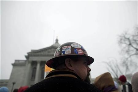 A union iron worker attends a rally outside of the Capitol building to protest against a proposed bill by Republican Governor Scott Walker in Madison, Wisconsin February 21, 2011. REUTERS/Darren Hauck