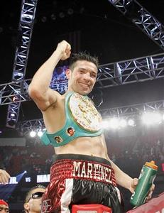 Sergio Martinez of Argentina celebrates his victory over WBC middleweight champion Julio Cesar Chavez Jr. of Mexico after their title fight at the Thomas & Mack Center in Las Vegas, Nevada September 15, 2012. REUTERS/Steve Marcus