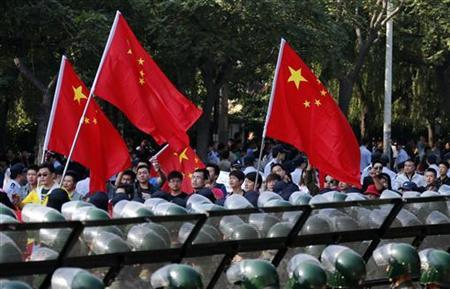 Protesters wave Chinese flags while marching outside Japanese embassy during a protest in Beijing September 16, 2012. REUTERS/David Gray